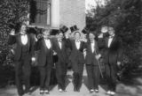 Students wearing top hats and tails
