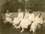 Brown envelope - Five students sitting in the garden
