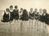 Brown envelope - Students paddling in the sea