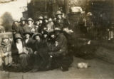 Index card 1923 - Students gathered outside the college