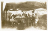 Index card 1935 - Students sitting at tables underneath a gazebo