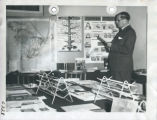 File: Exhibitions & Ceremonies - E. Casson looking at Metals display