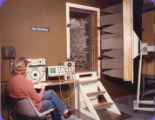 Display boards and general publicity 1970s - Student/Lecturer with monitoring equipment outside a sound-proof room