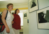 Opening of River House - Guests at a photography exhibition