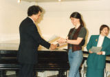 Unlabelled sleeves - Student receiving a certificate